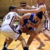 GEOFF SMITH — THE BERKSHIRE EAGLE Wahconah's Connor Noyes gets tangled up with the ball by Monument Mountain's Noel Powell, left, and Graham Herrick during Tuesday's Western Massachusetts Division III semifinal game at UMass.