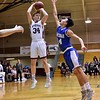 GEOFF SMITH — THE BERKSHIRE EAGLE Monument Mountain's Graham Herrick goes up for a jumpshot as Wahconah's Tom Burris reaches out to try and block the shot during Tuesday's Western Massachusetts Division III semifinal game at UMass.