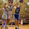 GEOFF SMITH — THE BERKSHIRE EAGLE Wahconah's Tom O'Connor grabs a defensive rebound as Monument Mountain's Kevin Troiano, center, and Graham Herrick also contest for the ball during Tuesday's Western Massachusetts Division III semifinal game at UMass.