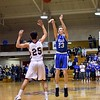 GEOFF SMITH — THE BERKSHIRE EAGLE Wahconah's Tom O'Connor lets go of a jumpshot as Monument Mountain's Kevin Troiano tries to close down on him during Tuesday's Western Massachusetts Division III semifinal game at UMass.