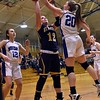 GEOFF SMITH — THE BERKSHIRE EAGLE Mount Everett's Madison Ullrich has her shot blocked by Monson's Sydnie DeVries during Tuesday's Western Massachusetts Division IV semifinal game at UMass.