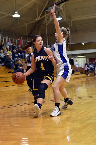 GEOFF SMITH — THE BERKSHIRE EAGLE Mount Everett's Gwen Carpenter looks to pass the ball around Monson's Lily Fabian during Tuesday's Western Massachusetts Division IV semifinal game at UMass.