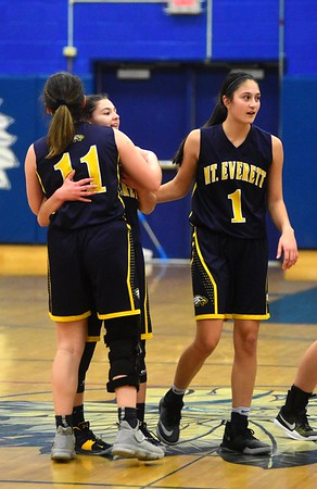 GILLIAN JONES — THE BERKSHIRE EAGLE<br /> Mount Everett's Gwendolyn Carpenter is congratulated Marion Devotl (11) and Madeline Vonruden (1) after breaking the school record of 1788 points, the most career points, during the game against Wahconah in Dalton. Thursday, January 10, 2019.