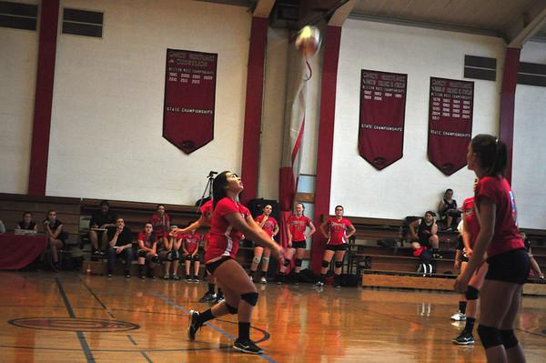Celia Bote volleys the ball. (Jack Guerino/ North Adams Transcript)