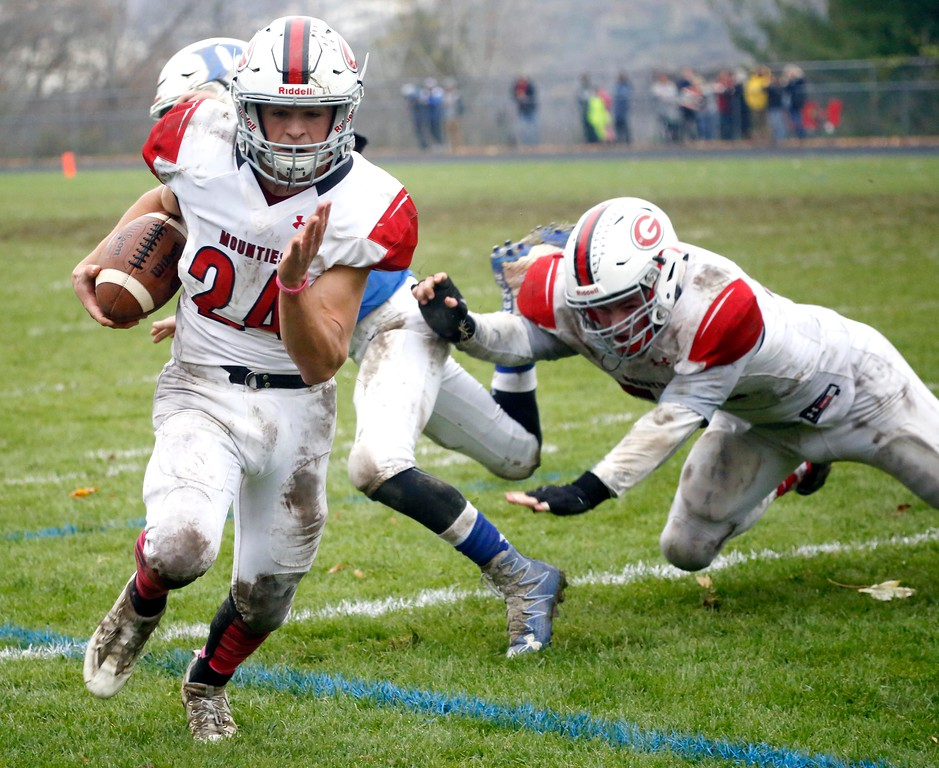 . Mount Greylock\'s Cal Messina runs into the endzone to score a two-point conversion in a football game at Drury High School in North Adams. Saturday, October 29, 2016. Stephanie Zollshan � The Berkshire Eagle | photos.berkshireeagle.com