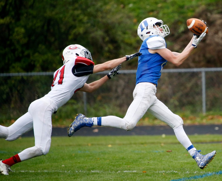 . Drury\'s Hayden Bird catches a pass and runs into the endzone for a touchdown in a football game against Mount Greylock at Drury High School in North Adams. Saturday, October 29, 2016. Stephanie Zollshan � The Berkshire Eagle | photos.berkshireeagle.com
