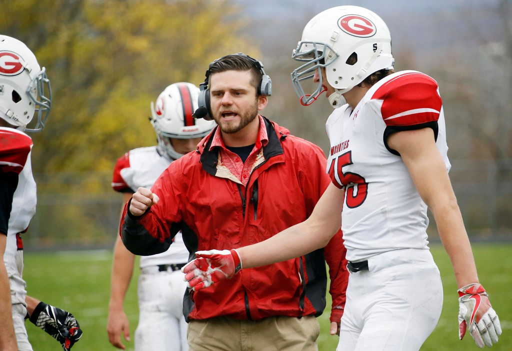 . Mount Greylock Head Coach Andrew Agostini talks to players on the sidelines in a football game at Drury High School in North Adams. Saturday, October 29, 2016. Stephanie Zollshan � The Berkshire Eagle | photos.berkshireeagle.com