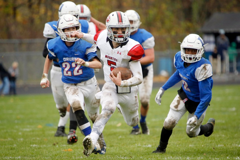 . Mount Greylock quarterback Michael Wellspeak sprints through a crowd of Drury defenders in a football game at Drury High School in North Adams. Saturday, October 29, 2016. Stephanie Zollshan � The Berkshire Eagle | photos.berkshireeagle.com