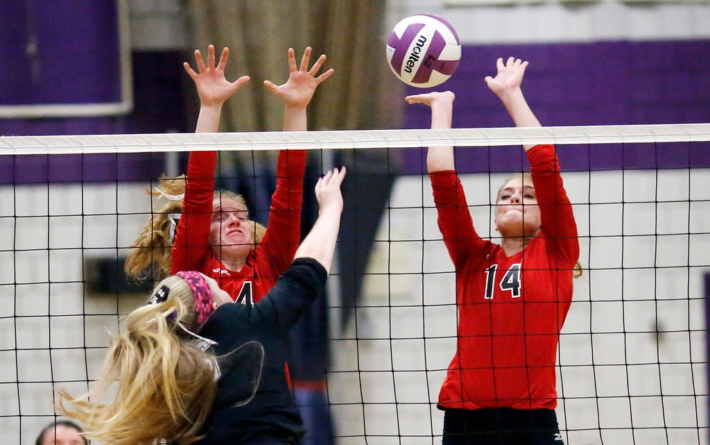 . Mount Greylock\'s Maddie Albert and Hannah Byrnes stop a ball at the net spiked by Pittsfield\'s Katara Mullett in a volleyball match at Pittsfield High School. Wednesday, October 26, 2016. Stephanie Zollshan � The Berkshire Eagle   photos.berkshireeagle.com