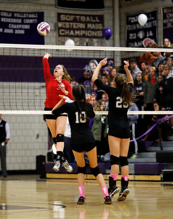 . Mount Greylock\'s Caroline Hadley spikes the ball over the net in a volleyball match at Pittsfield High School. Wednesday, October 26, 2016. Stephanie Zollshan � The Berkshire Eagle | photos.berkshireeagle.com