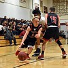 GEOFF SMITH — THE BERKSHIRE EAGLE<br /> Mount Greylock's Sam Dils dribbles the ball around a screen set by teammate Cole Wojtkowski during Saturday's Western Massachusetts Division III quarterfinal game against Sabis in Springfield.