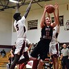 GEOFF SMITH — THE BERKSHIRE EAGLE<br /> Mount Greylock's Sean McCormack goes up for a shot in traffic during Saturday's Western Massachusetts Division III quarterfinal game against Sabis in Springfield.