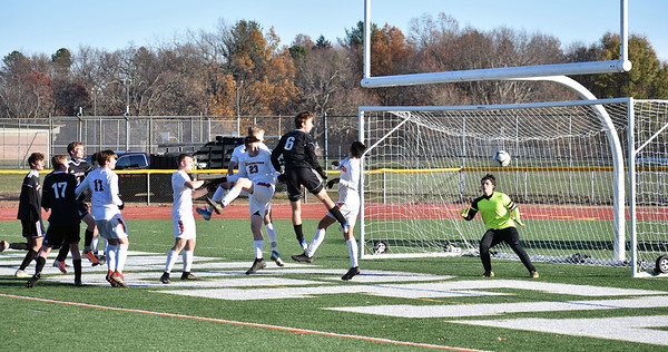 GEOFF SMITH — THE BERKSHIRE EAGLE<br /> Mount Greylock's Will Starenko heads a shot just off target during Saturday's Western Massachusetts Division VIII final loss to Belchertown.