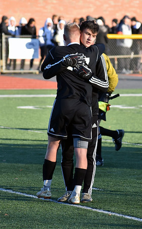 GEOFF SMITH — THE BERKSHIRE EAGLE<br /> Mount Greylock's Tate Kuster, front, is embraced by a teammate after Saturday's Western Massachusetts Division VIII final loss to Belchertown.