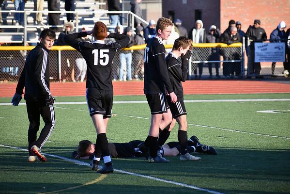 GEOFF SMITH — THE BERKSHIRE EAGLE<br /> Members of the Mount Greylock boys soccer team react after the final whistle of Saturday's Western Massachusetts Division VIII final against Belchertown. The Mounties lost 2-1.