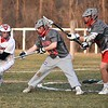 GEOFF SMITH — THE BERKSHIRE EAGLE<br /> Mount Greylock's Tate Kuster cradles the ball as Pope Francis goaltender Beck Avery-Dyjach checks him and defenseman Ryan Crawford looks on during Friday's game in Williamstown.