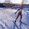 Lenox skier Ely Carroll passes the halfway point in the Boy's JV Nordic ski race.