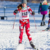 Natalie Pompi rounds a corner during the first lap of the Girls' JV Nordic Ski race Sunday.