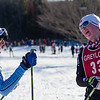 Mt. Greylock's Jakin Miller congratulates NMH's Adam Carlisle Sunday. Carlisle placed first, Miller 2nd in the Boy's Varsity race.