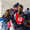 Members of Mt. Greylock's Girls' Varsity team celebrate after finishing Sunday.