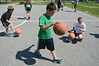 During an exercise called 'double dribble' kids see how many times they can dribble the ball on the courts outside of the Williamstown Youth Center on Wednesday August 9, 2013 during Olympic Day, which hosted a day of athletic activities for campers. Olympic Day commemorates the birth of the modern Olympic Games and is an international effort to promote fitness, well being and the ideals of fair play, perseverence, respect and sportsmanship. (Gillian Jones/North Adams Transcript)
