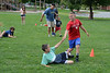 Joseph Eisen, 10, and his partner Tibi Englamyer, 10, take a tumble during the three-legged race outside the Williamstown Youth Center on Wednesday August 9, 2013 during Olympic Day, which hosted a day of athletic activities for campers. Olympic Day commemorates the birth of the modern Olympic Games and is an international effort to promote fitness, well being and the ideals of fair play, perseverence, respect and sportsmanship. (Gillian Jones/North Adams Transcript)