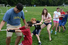 With the help of their volunteer counselors Alejandro Viquez-Salas, left, and Amy Larabee, 16, center, these kids do the tug of war outside the Williamstown Youth Center on Wednesday August 9, 2013 during Olympic Day, which hosted a day of athletic activities for campers. Olympic Day commemorates the birth of the modern Olympic Games and is an international effort to promote fitness, well being and the ideals of fair play, perseverence, respect and sportsmanship. (Gillian Jones/North Adams Transcript)