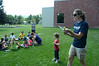 Olympian swimmer Samantha Livingstone of Peabody, MA, who performed in the 2000 Olympics, tells a story to campers outside the Williamstown Youth Center on Wednesday August 9, 2013 during Olympic Day, which hosted a day of athletic activities for campers. Olympic Day commemorates the birth of the modern Olympic Games and is an international effort to promote fitness, well being and the ideals of fair play, perseverence, respect and sportsmanship. (Gillian Jones/North Adams Transcript)
