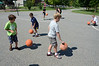During an exercise called 'double dribble' Eli Levy, 8, center, joins other campers in seeing how many times he can dribble the ball on the courts outside of the Williamstown Youth Center on Wednesday August 9, 2013 during Olympic Day, which hosted a day of athletic activities for campers. Olympic Day commemorates the birth of the modern Olympic Games and is an international effort to promote fitness, well being and the ideals of fair play, perseverence, respect and sportsmanship. (Gillian Jones/North Adams Transcript)