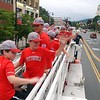 BEN GARVER — THE BERKSHIRE EAGLE<br /> The Pittsfield American Little League All-Star team rides to City Hall on a Pittsfield Fire Department ladder truck to meet with Mayor Linda Tyer.