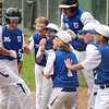 GEOFF SMITH — THE BERKSHIRE EAGLE<br /> Pittsfield National team members celebrate a two-run home run hit by Nick Guachione (11) during the 11-12 District I Little League championship game at Chamberlain Field in Dalton on Friday, July 14, 2017.