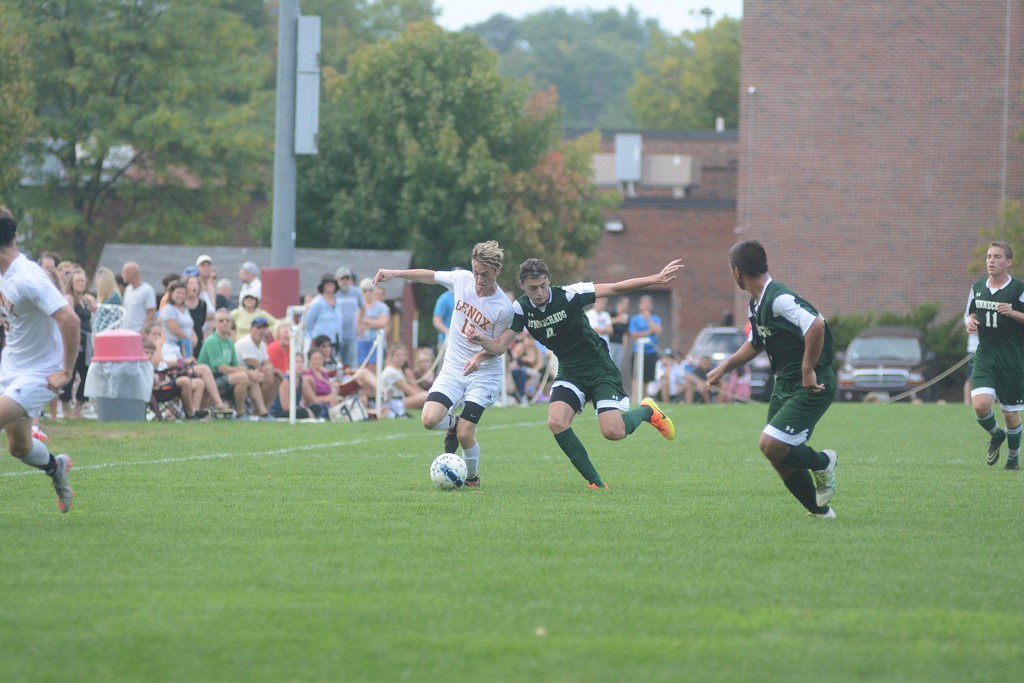 . Lenox\'s Luke Murphy tries to keep possession of the ball from Minnechaug\'s Will Ryan during a soccer game in Lenox on Saturday, September 10, 2016. Gillian Jones � The Berkshire Eagle | photos.berkshireeagle.com
