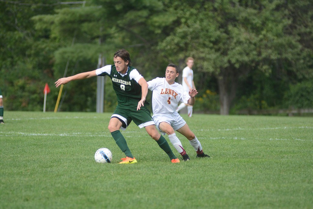 . Lenox\'s Ian Laurin tries to gain possession of the ball from Minnechaug\'s Will Ryan during a soccer game in Lenox on Saturday, September 10, 2016. Gillian Jones � The Berkshire Eagle | photos.berkshireeagle.com