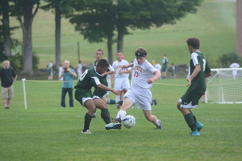 . Lenox\'s Joe Bouvier tries to keep possession of the ball from Minnechaug\'s Jacob Belemjian during a soccer game in Lenox on Saturday, September 10, 2016. Gillian Jones � The Berkshire Eagle | photos.berkshireeagle.com