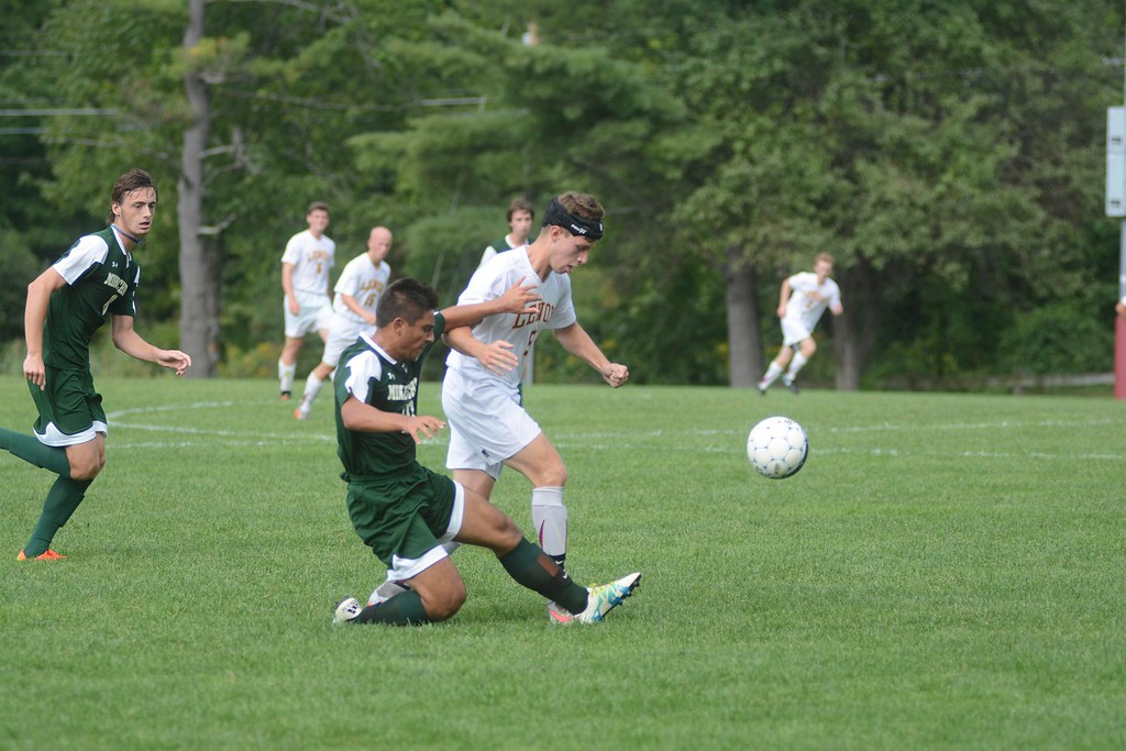 . Lenox\'s Michael Abdalla tries to gain possession of the ball from Minnechaug\'s Jacob Belemjian during a soccer game in Lenox on Saturday, September 10, 2016. Gillian Jones � The Berkshire Eagle | photos.berkshireeagle.com
