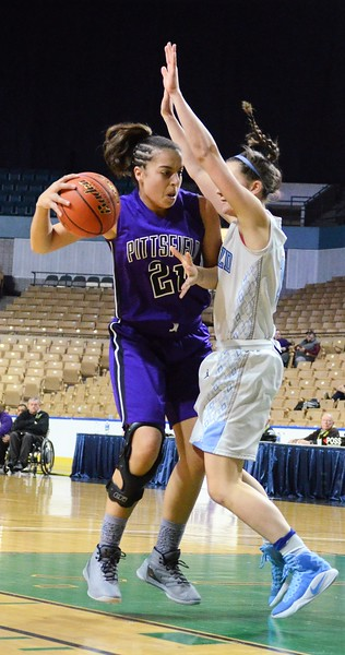 GEOFF SMITH - THE BERKSHIRE EAGLE<br /> Pittsfield sophomore Lexi Garvey tries to go up for a shot against Medfield in the MIAA Division II state semifinal at the DCU Center. March 13, 2017.