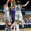 GEOFF SMITH - THE BERKSHIRE EAGLE<br /> Pittsfield's Peyton Steinman has her shot block by two Medfield defenders during the MIAA Division II state semifinal game at the DCU Center. March 13, 2017.