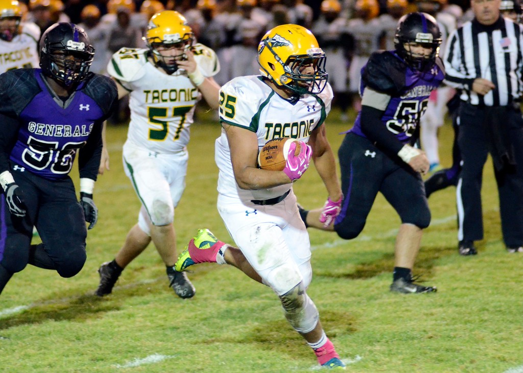 . Taconic running back Cedric Rose takes a carry up the field against Pittsfield on Friday night at Wahconah Park.