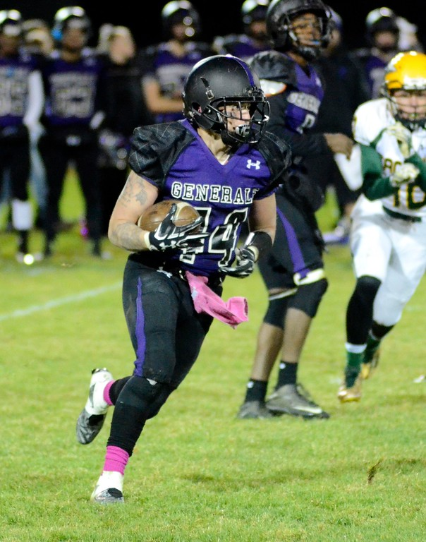 . Pittsfield fullback Edwin Rodriguez takes a carry up the field against Taconic on Friday night during his team\'s city rivalry game at Wahconah Park.