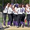 GEOFF SMITH — THE BERKSHIRE EAGLE<br /> The Pittsfield softball team celebrates with Giuliana Pierce, center, after Pierce hit a solo home run against Hoosac Valley.