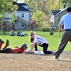 GEOFF SMITH — THE BERKSHIRE EAGLE<br /> Hoosac Valley baserunner Maddi Puppolo and Pittsfield shortstop Madison Tobin look to the umpire after Tobin tagged Puppolo out during Monday's game in Pittsfield