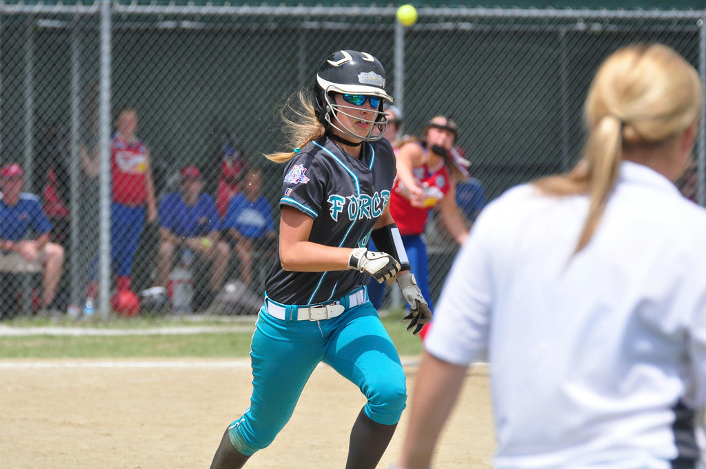 . Berkshire Force\'s Allie Hunt runs to first base after she bunts the ball in her team\'s game against Rochester, on Sunday, August, 3, 2014. Gillian Jones / Berkshire Eagle Staff / photos.berkshireeagle.com