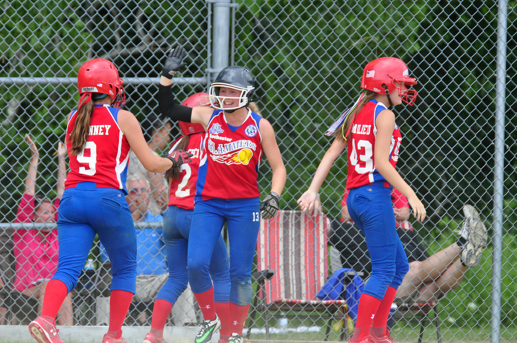 . The Rochester Slammers celebrate a three run lead against Berkshire Force in the 9th inning, on Sunday, August, 3, 2014. Gillian Jones / Berkshire Eagle Staff / photos.berkshireeagle.com