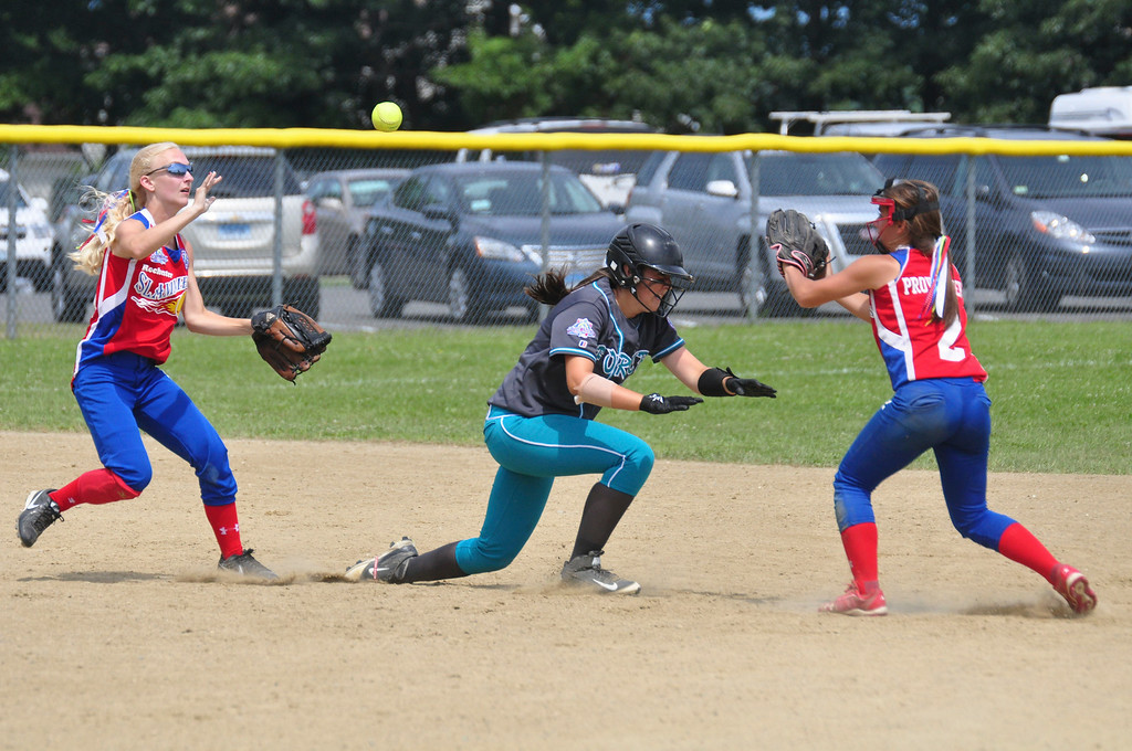 . Berkshire Force\'s Emily Koldys is caught between two Rochester players as she tries to get safely back to base, on Sunday, August, 3, 2014. She manages to make it safely back to second base. Gillian Jones / Berkshire Eagle Staff / photos.berkshireeagle.com