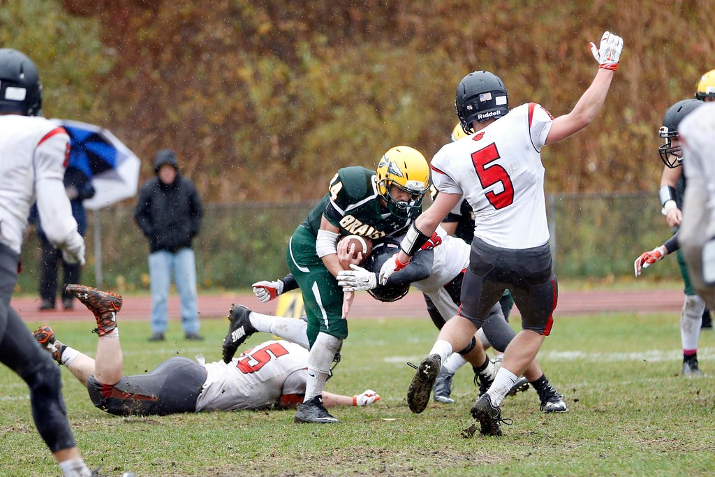 . Taconic\'s Zach Gage thwarts many attempts by South Hadley defenders to tackle him before running through to the endzone for a touchdown in a football game at Taconic High School in Pittsfield. Saturday, October 22, 2016. Stephanie Zollshan � The Berkshire Eagle | photos.berkshireeagle.com
