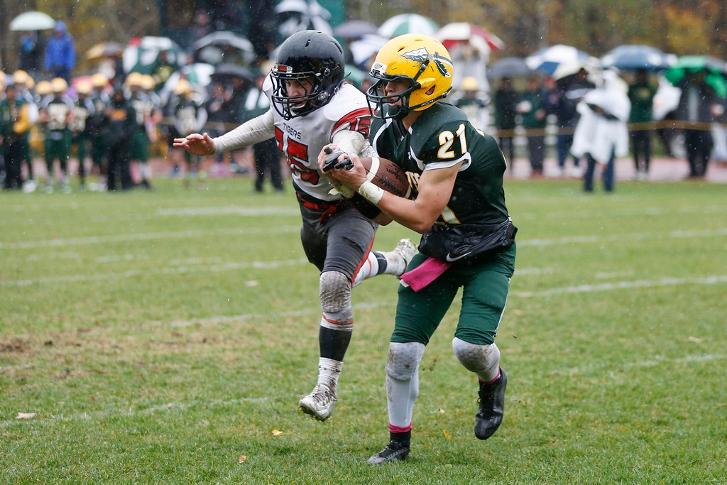 . Taconic\'s Devon Walker catches a touchdown pass in the endzone despite an attempt by South Hadley\'s Ryan Mooney to grab his hand away in a football game at Taconic High School in Pittsfield. Saturday, October 22, 2016. Stephanie Zollshan � The Berkshire Eagle | photos.berkshireeagle.com