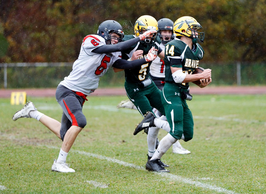 . Taconic\'s Jack Cooney blocks South Hadley\'s Jack Dawson from touching Zach Gage, allowing Gage to run into the endzone for a Taconic touchdown in a football game at Taconic High School in Pittsfield. Saturday, October 22, 2016. Stephanie Zollshan � The Berkshire Eagle | photos.berkshireeagle.com