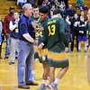 GEOFF SMITH - THE BERKSHIRE EAGLE<br /> Taconic captains Izaiya Mestre (13), Deonte Sandifer and Brett Murphy accept the runner-up trophy after the Western Mass. Division II championship game against Longmeadow. March 11, 2017.