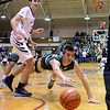 GEOFF SMITH - THE BERKSHIRE EAGLE<br /> Taconic's Brett Murphy dives for a loose ball during the Western Mass. Division II championship game against Longmeadow. March 11, 2017.