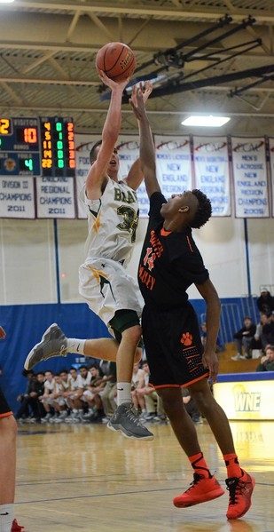 GEOFF SMITH - THE BERKSHIRE EAGLE<br /> Taconic's Brett Murphy shoots a jumpshot over South Hadley's Calvin Bridges in the Western Mass. Division II semifinals.